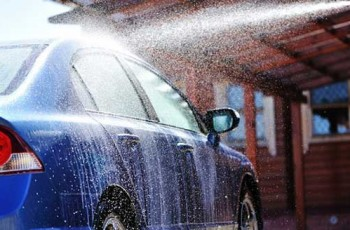 blue car being washed