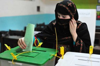 women in election booth