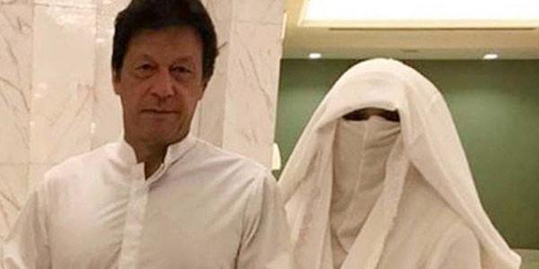 bushra bibi and imran khan in white dress