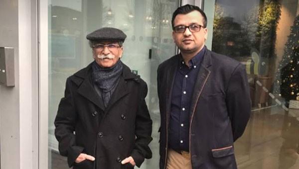 rana iqbal in a black coat