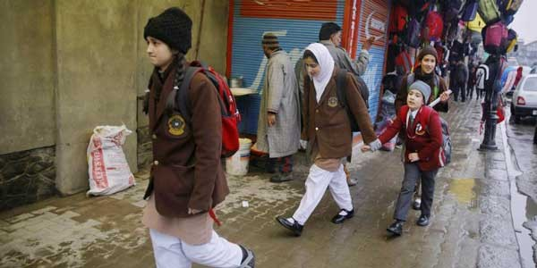 students wearing school uniform and sweaters